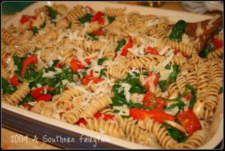 Pasta with garlic, tomatoes, spinach, parmesan and mushrooms