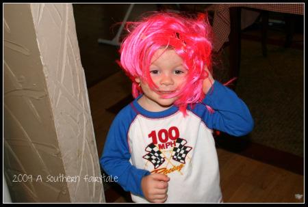 Monkey in a pink wig