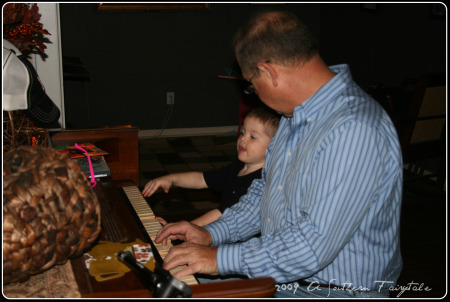 playing piano with grandpa