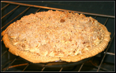 sour cream apple pie in oven