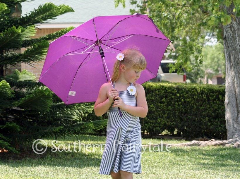 Princess dancing under her umbrella