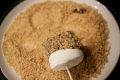 s'mores skewers in crushed graham crackers
