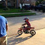 monkey rides a dirtbike