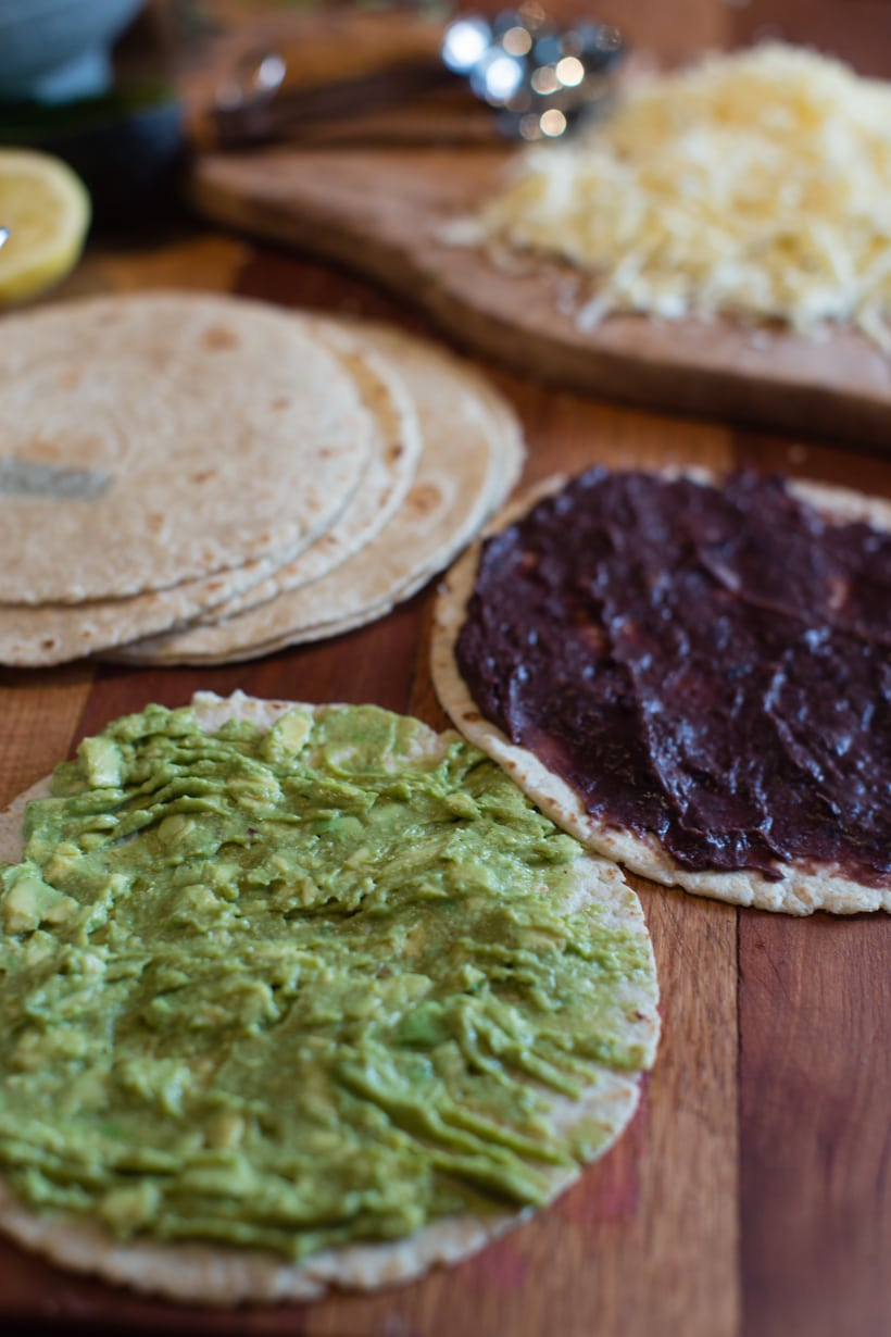 refried black beans and mashed avocado quesadillas