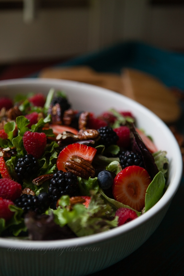 summer salad with berries and pecans