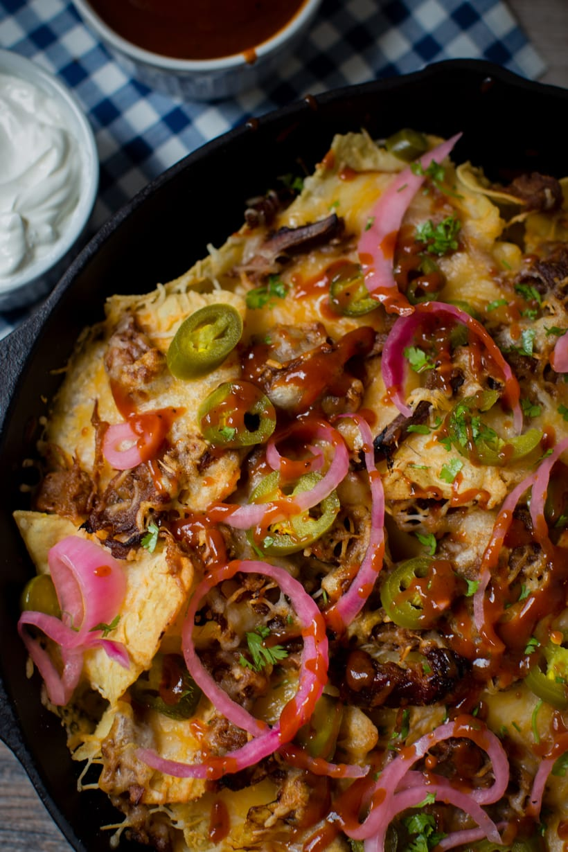 slow cooked pulled beef brisket skillet nachos with a tex mex flair