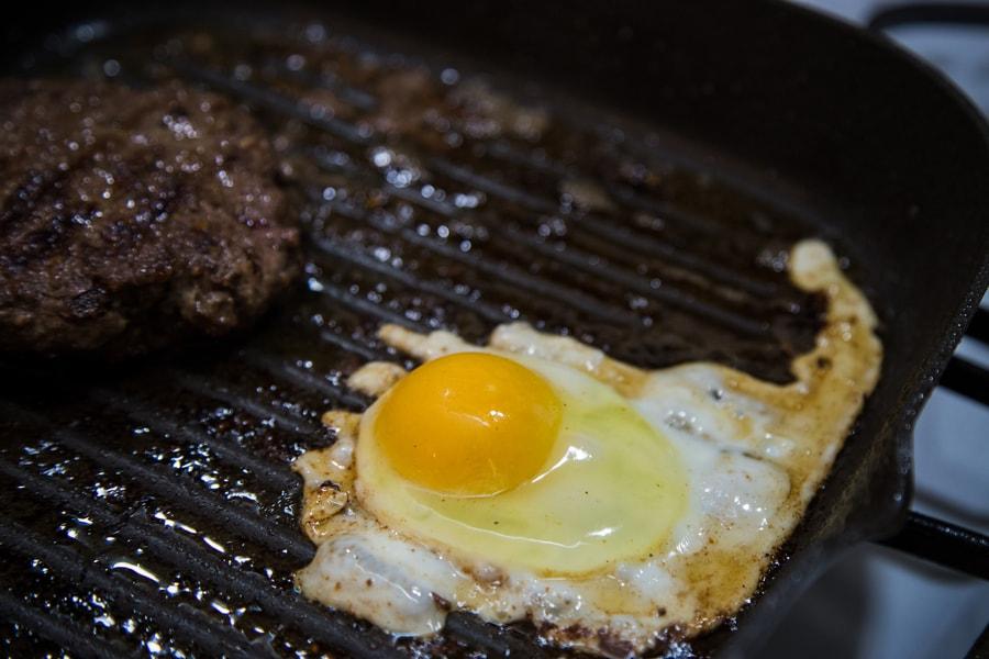 over easy egg for the keto friendly burger bowls