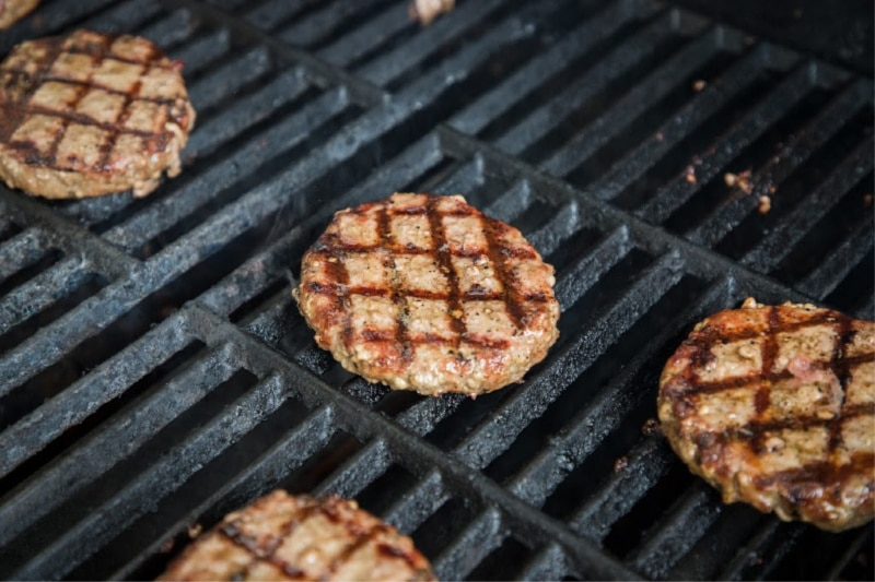 frozen burgers on the grill