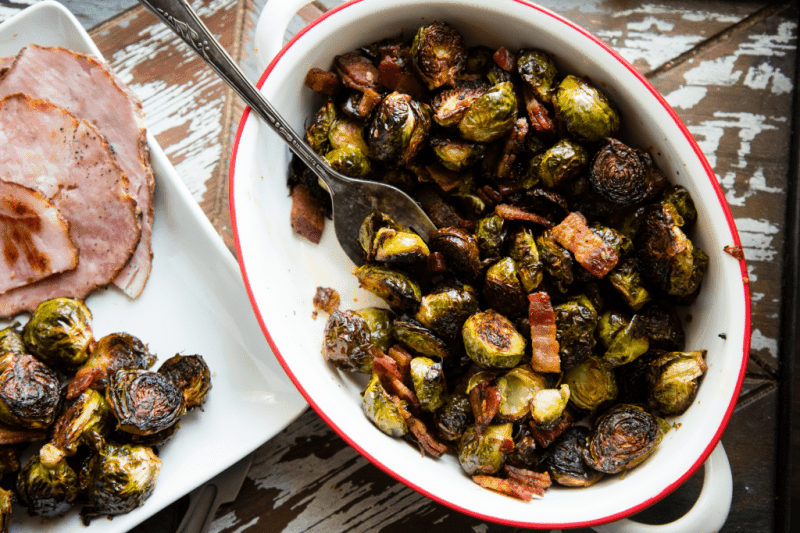 One Pan Sweet and Spicy Brussels Sprouts with Bacon -- these sheet pan brussels sprouts are easy to make and the slightly sweet, slightly spicy glaze, plus the bacon make them irresistible! | asouthernfairytale.com #sheetpan